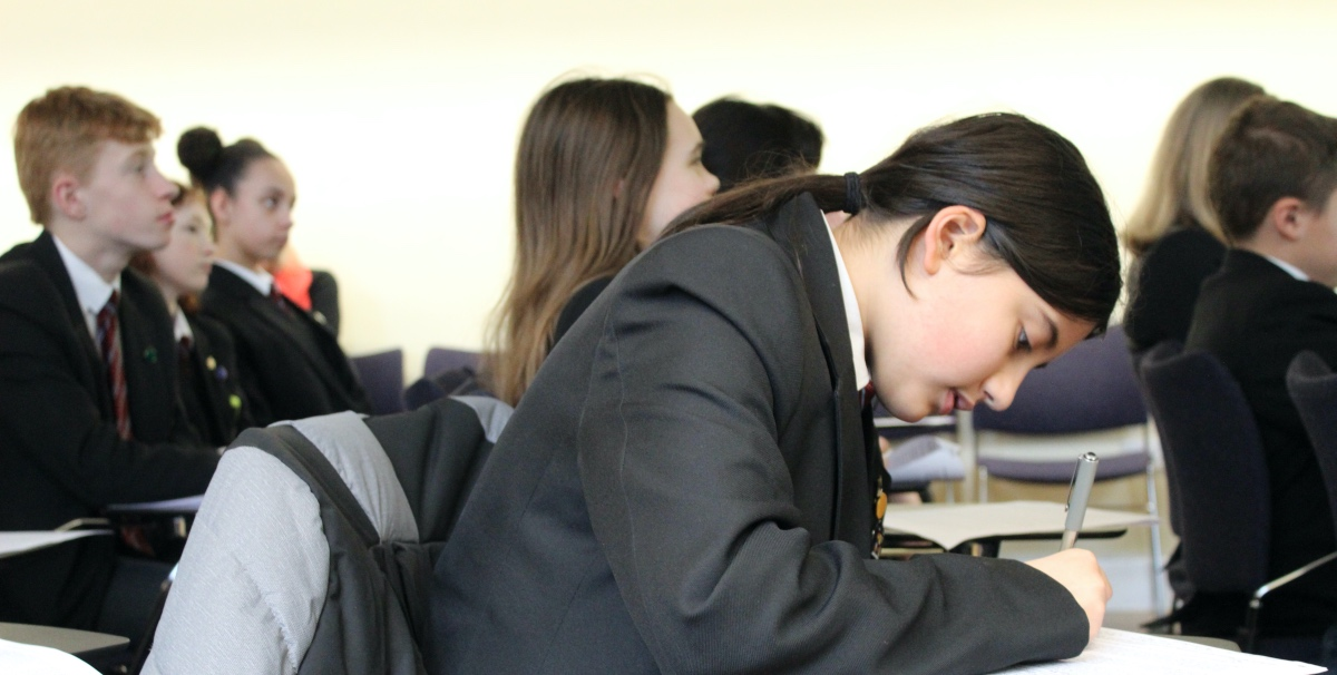 A prospective applicant making notes during a visit to Oxford.