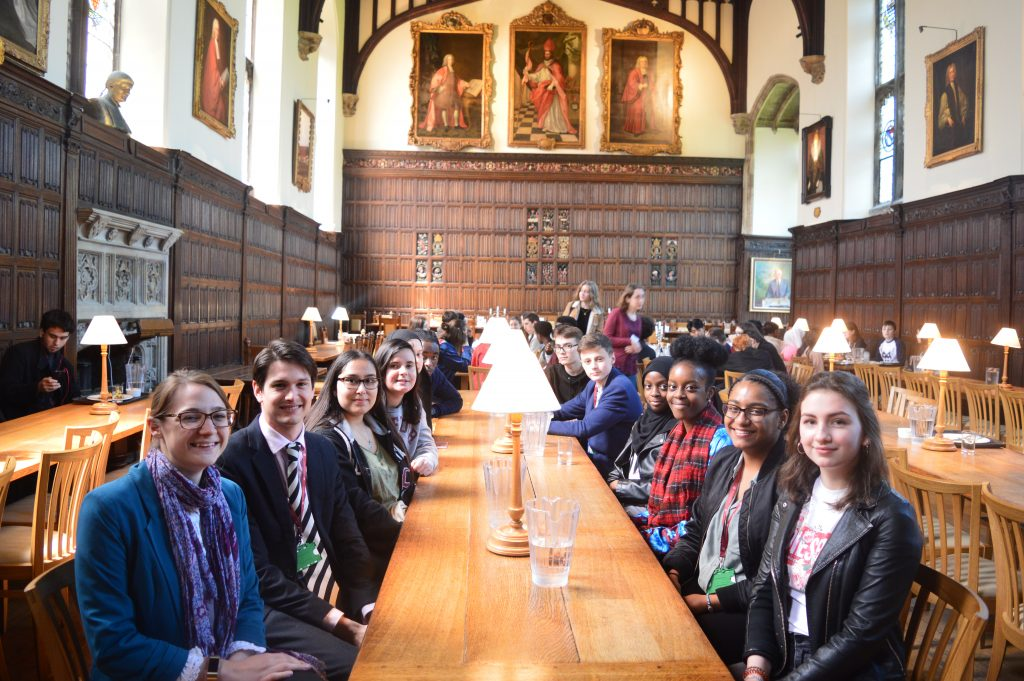 A group of students in Magdalen College Hall for lunch.