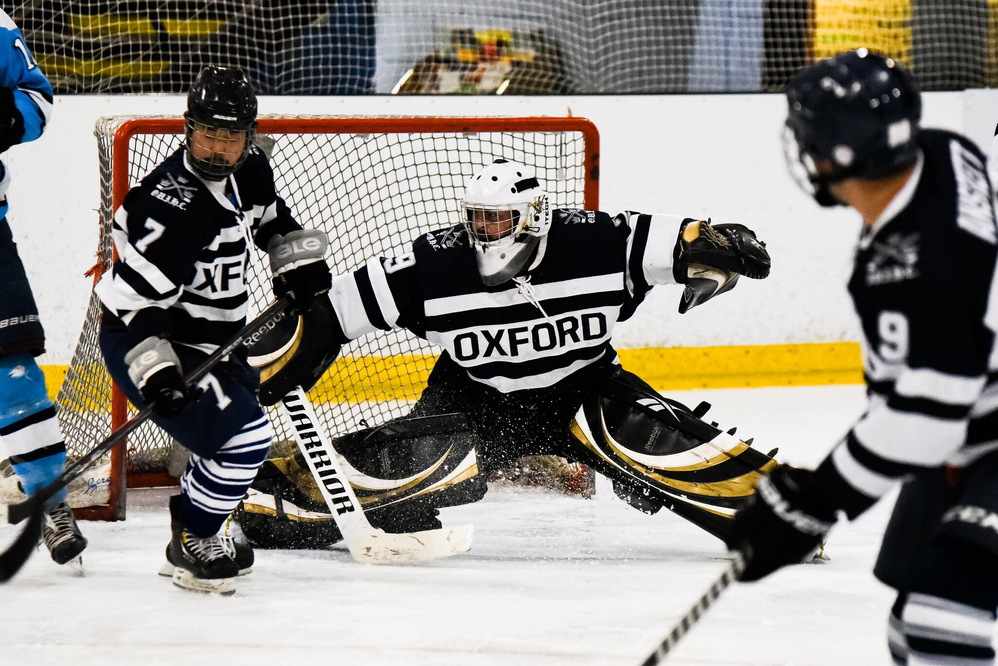 Three students from the Oxford Ice Hockey team playing in the Varsity match against Cambridge