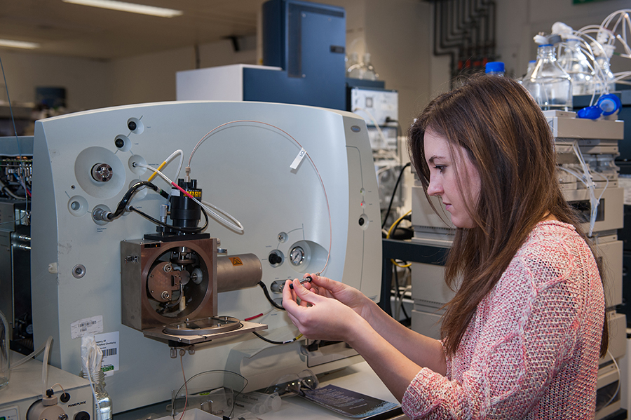 Student using equipment in a lab