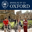 MBA students walk across Radcliffe Square in the sunshine, Oxford