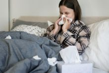 Sick student on bed with flu