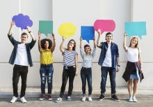 Six students holding speech bubbles