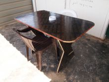 Table and chair fashioned out of flooring.