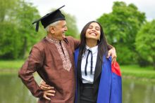 A student in a DPhil graduation robe