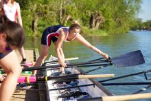 Women's rowing team getting into the boat