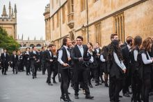 Students queuing in Radcliffe Square wearing sub fusc