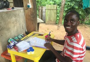 Albert Aryee labels plastic bags for collecting samples of leaves