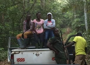 Research team driving into the field on top of truck