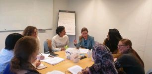 Pavandeep and colleagues round a conference table