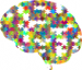 Illustration of a brain as a multicoloured jigsaw puzzle with several pieces missing