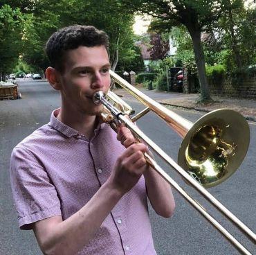 Reuben T. playing a Trumpet. Credits: Reuben T.