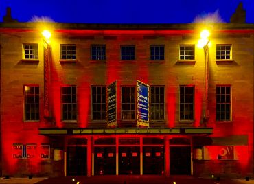 Oxford Playhouse for the #lightitinred campaign; image Ash Bale, Oxford Playhouse