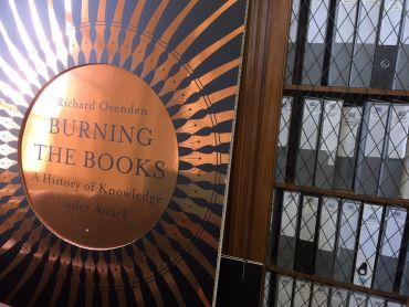 Burning the Books signage in office