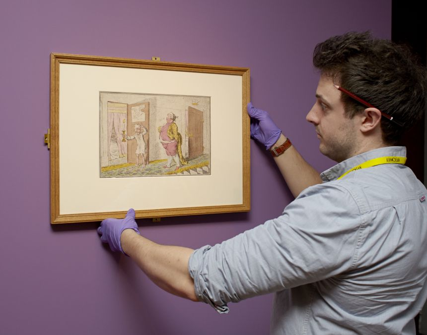 Ashmolean staff hanging a James Gillray caricature