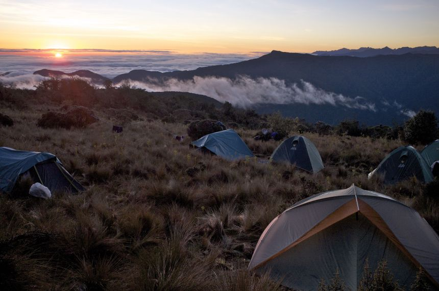 The tents at sunrise are 3500 m up in the Peruvian Andes, looking out over the Amazon Basin