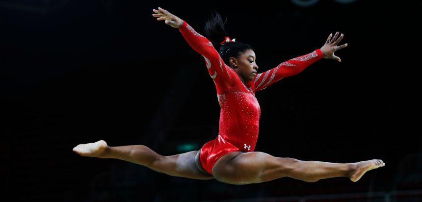 Simone Biles in mid-jump