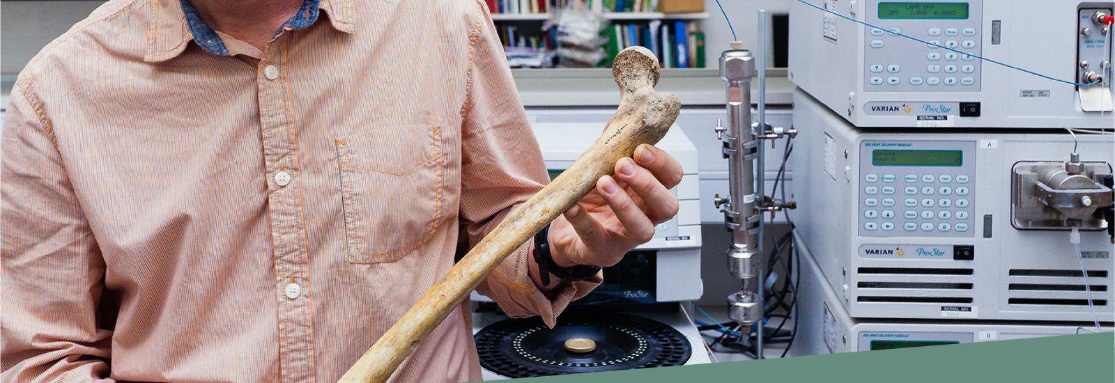 scientist with bone