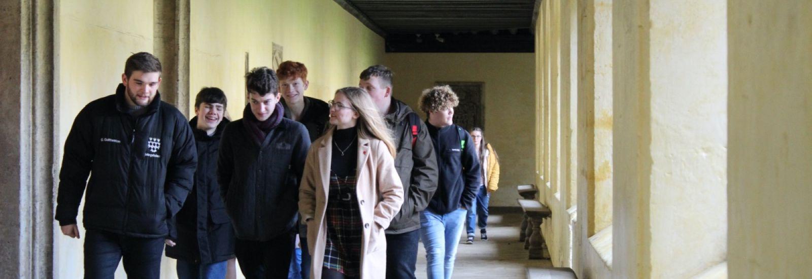 Student ambassador showing prospective students around Magdalen College.