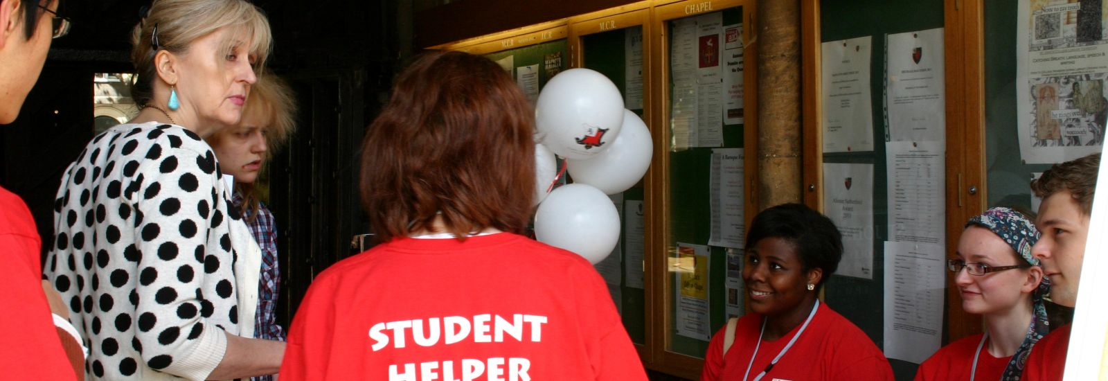 Student ambassadors welcoming families to an Open Day at St John's College