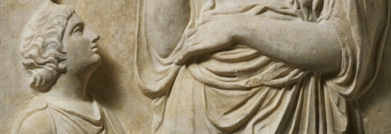 Greek carved marble relief showing a servant looking up at a woman