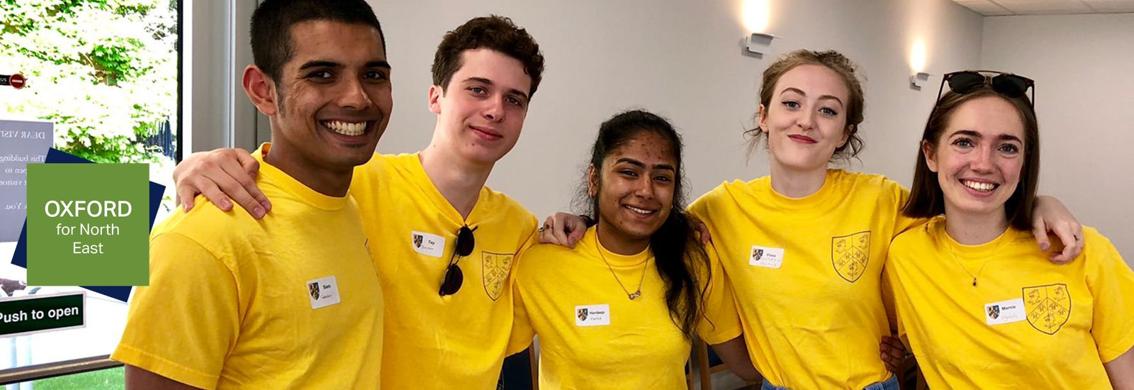 students wearing yellow t-shirt