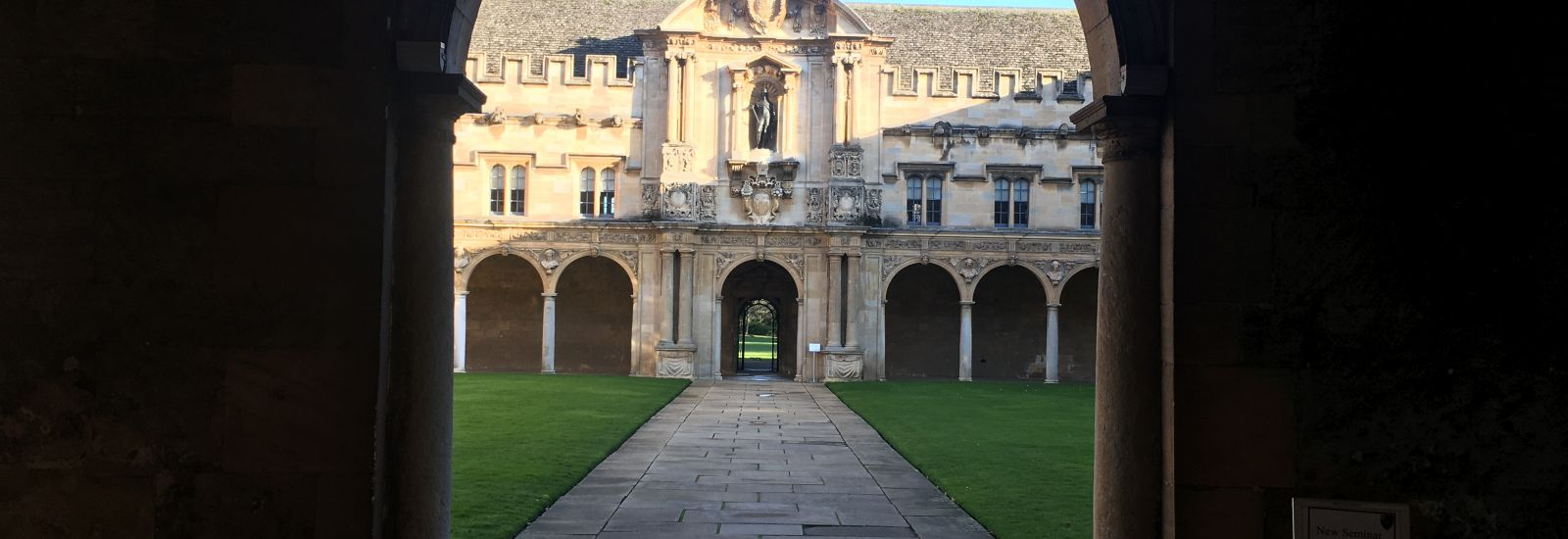 A view of Canterbury Quad at St John's College, Oxford through the archway
