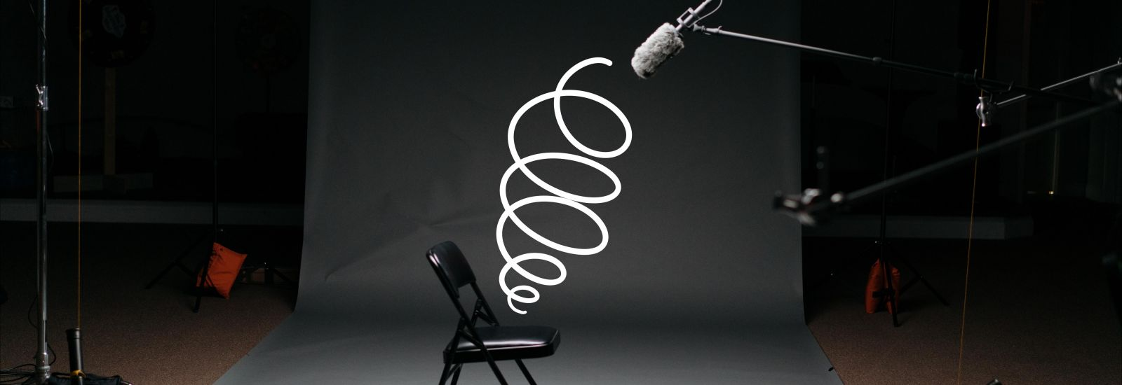A graphic of a coiled spring sits in an interview chair