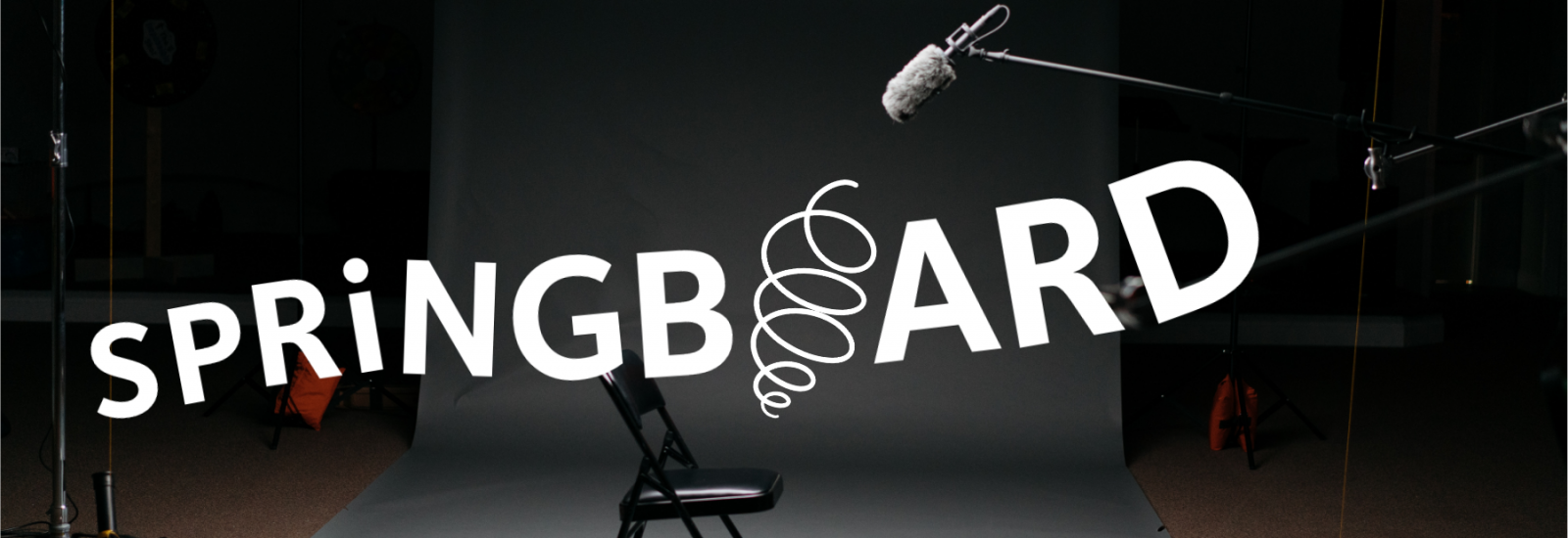 Springboard logo over photo with an empty chair and microphone in a recording studio