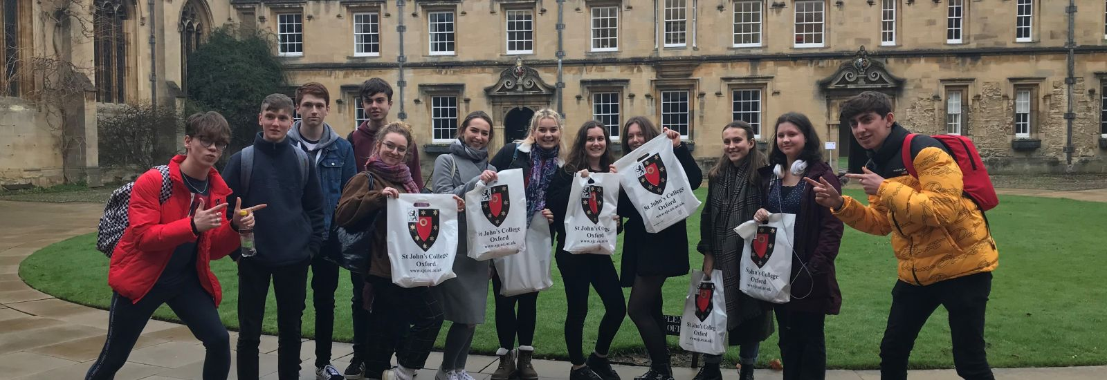 A group of secondary school pupils attending a college tour at St John's College