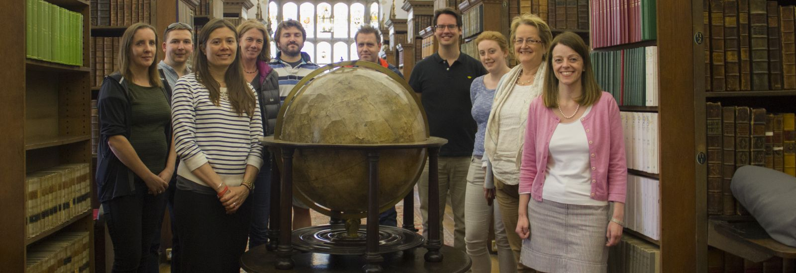 A group of teachers attending the St John's College teachers' residential, touring the college library.