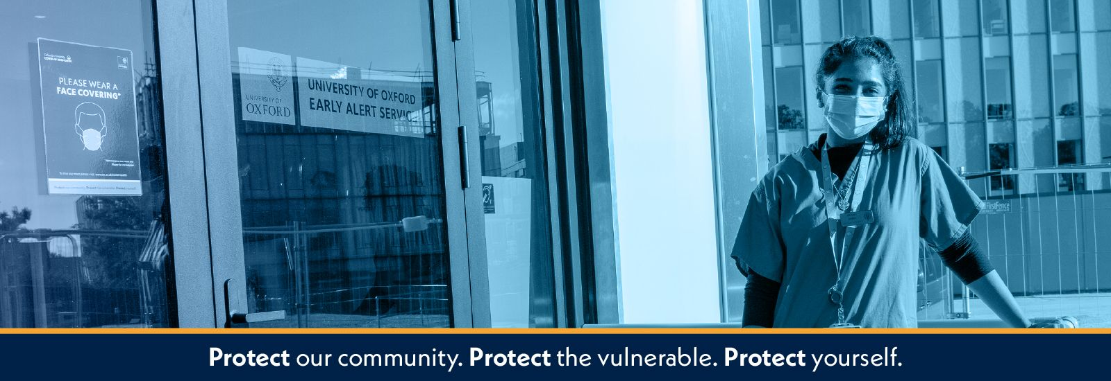 Medic standing outside a testing facility with the words Protect our community, protect the vulnerable, protect yourself