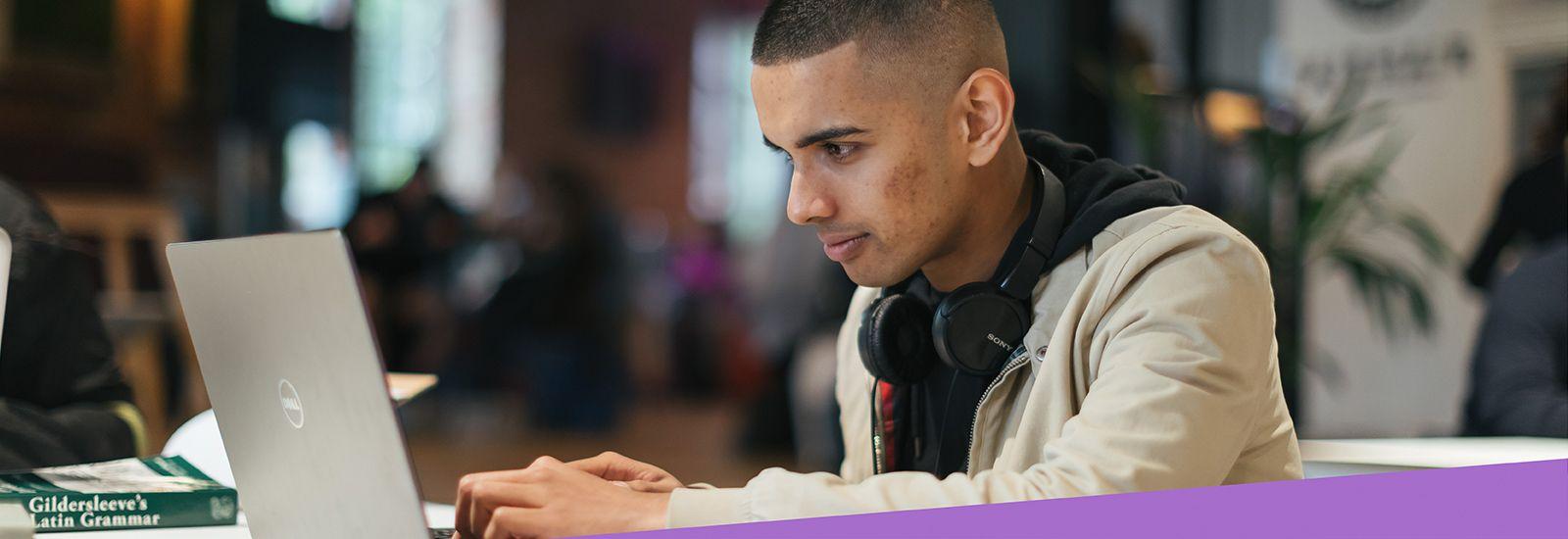 Undergraduate student using laptop