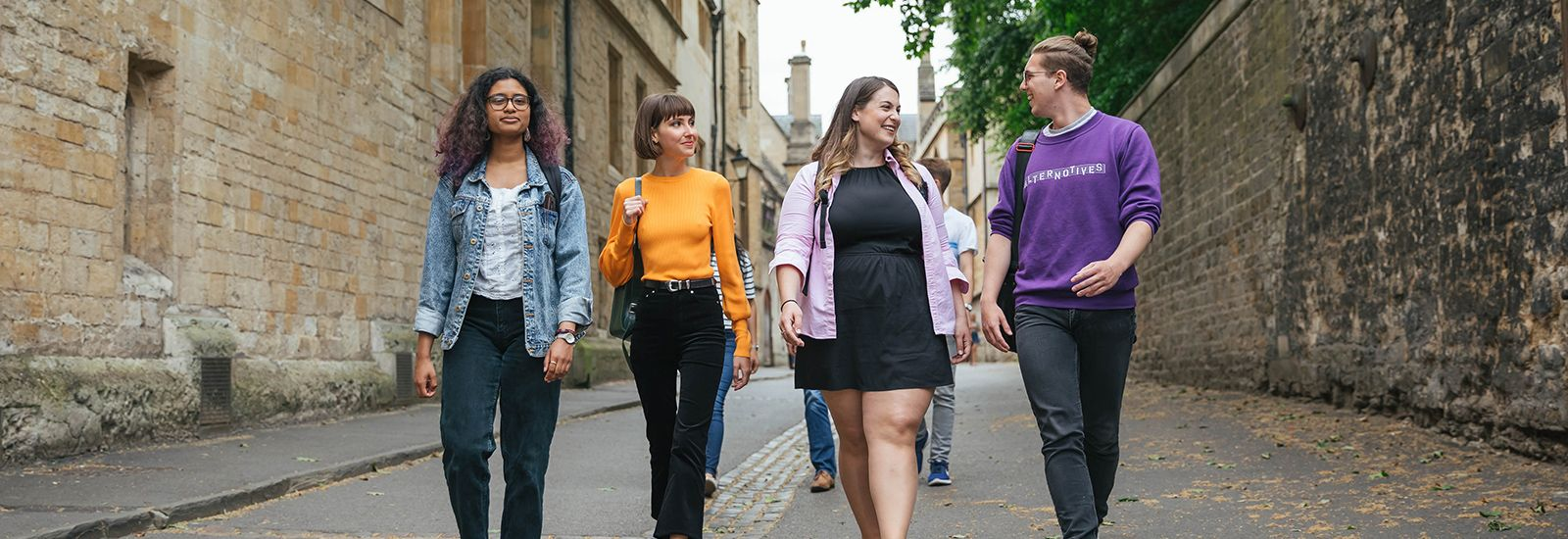 Four students walking together