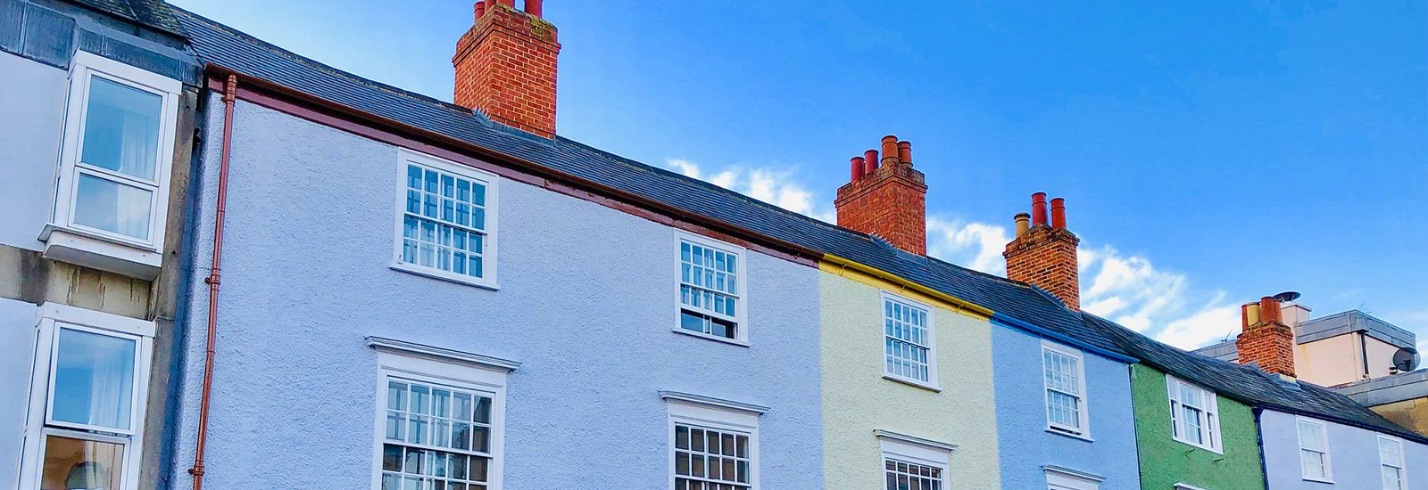 Colourful houses on Longwall Street on a sunny day