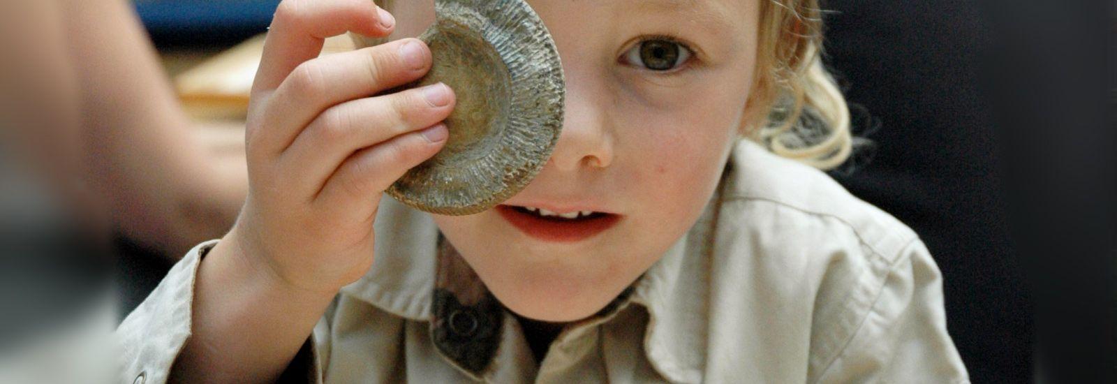 little boy with fossil