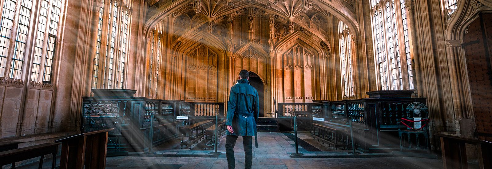 A student standing in the Divinity School