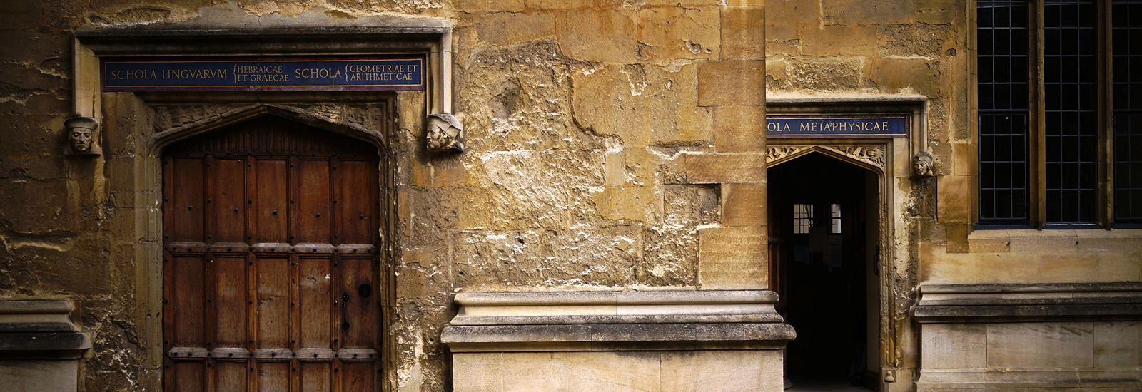 Two wooden doors inside the Bodleian's Old Schools quad