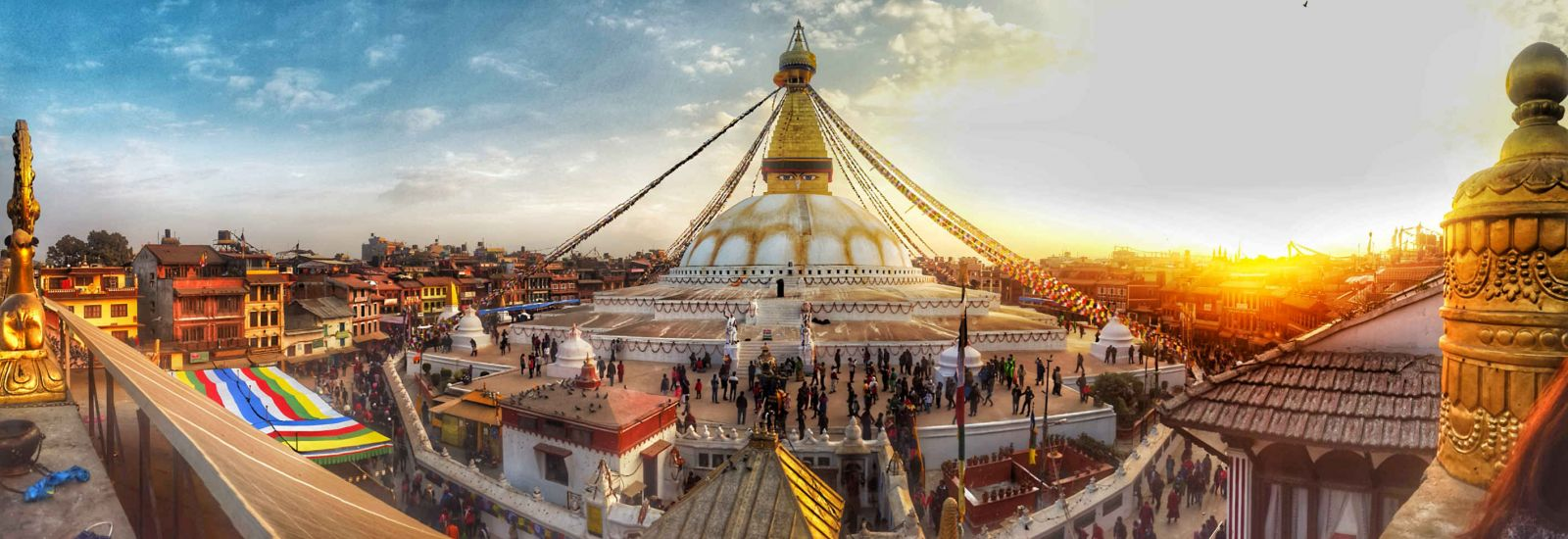 The dome-shaped Boudhanath Stupa monument in Nepal, with streamers flying from its steeple.