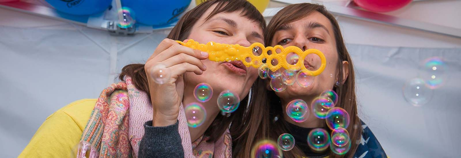 A photograph of two volunteers at the Curiosity Carnival