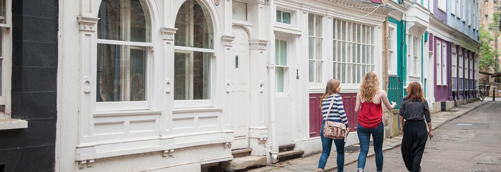 Three students walking down an Oxford street