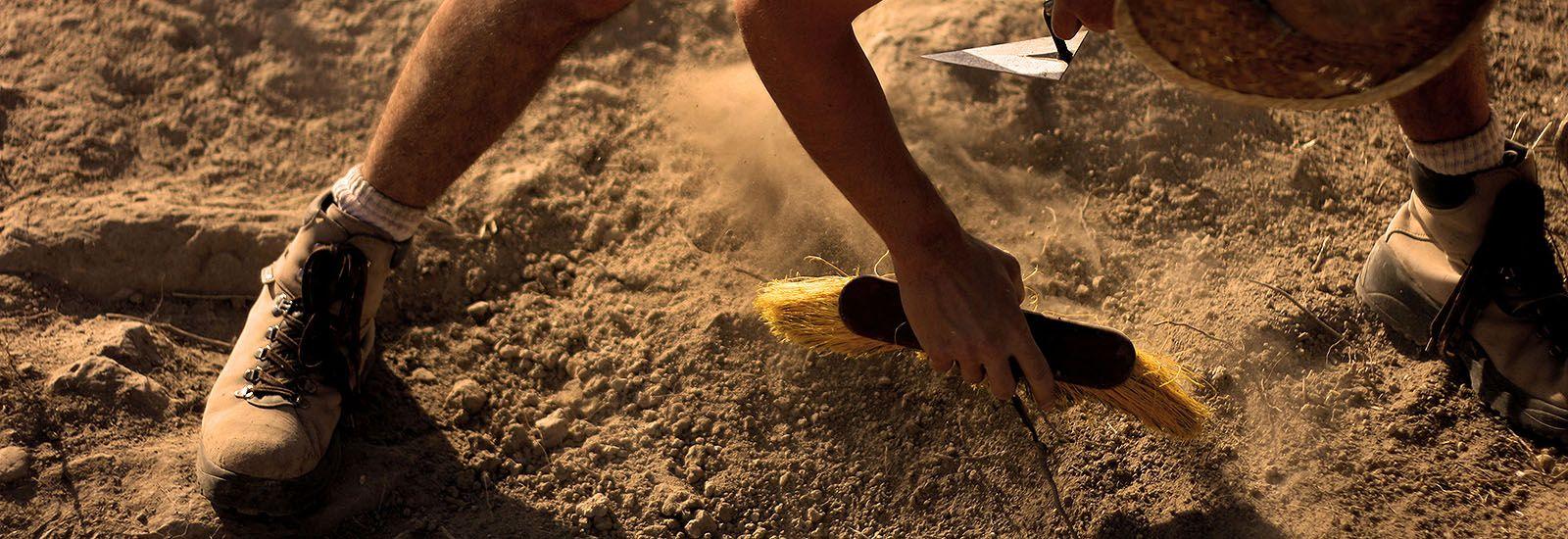An archaeologist undertaking fieldwork
