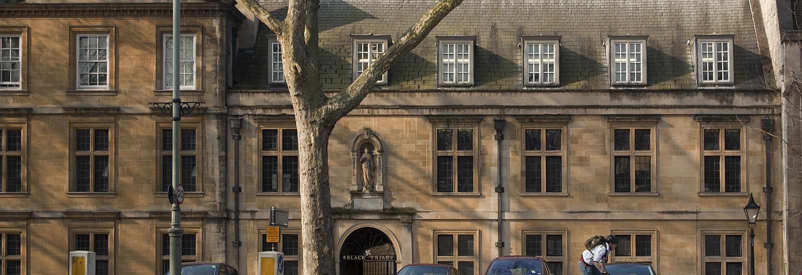 Blackfriars College building behind a tree