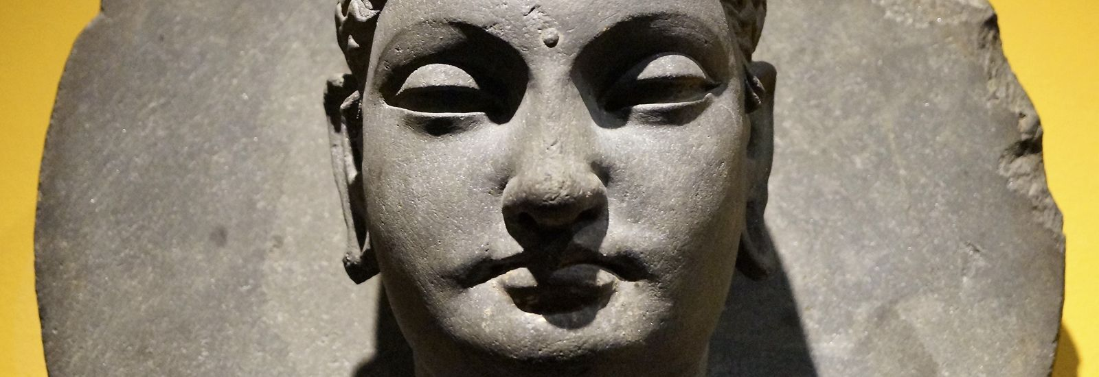 Close up of a stone carving of a face