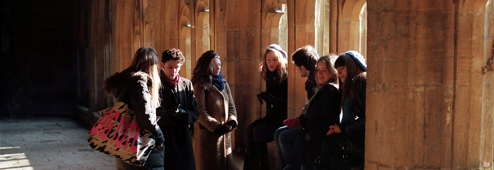 A group of students in cloisters