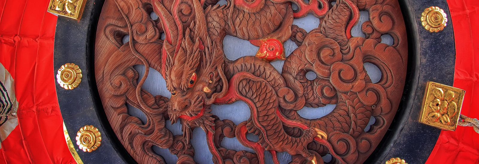 Close up of a wooden carved dragon
