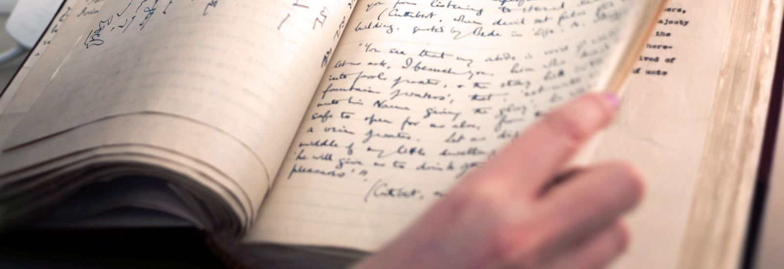 A close up of a book with handwritten text inside