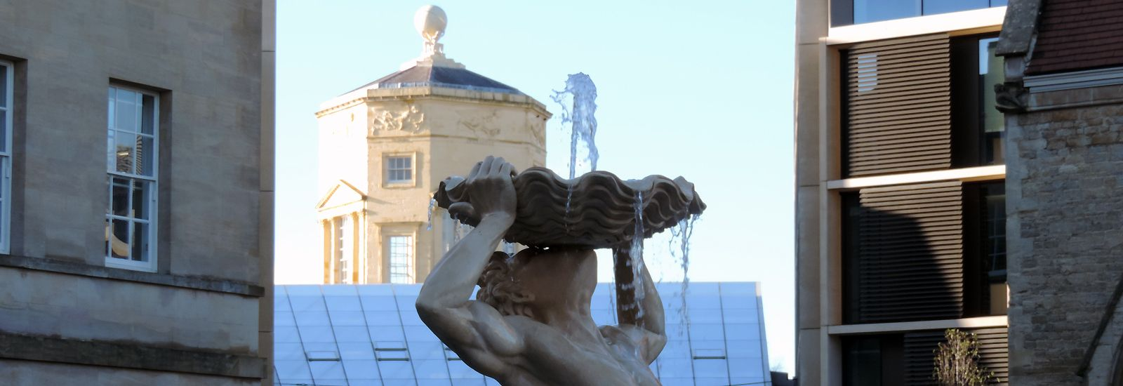 A water fountain with the Radcliffe Observatory Tower behind
