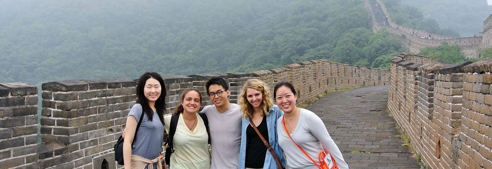 5 students standing on the Great Wall of China