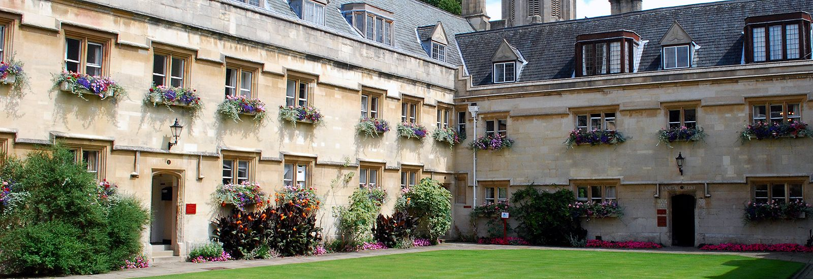A quad at Pembroke College on a sunny day